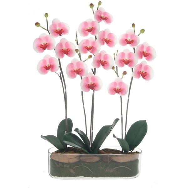 Se ela é uma romântica dos tempos modernos, as flores estão ultrapassadas, são bocados de Natureza morta com um prazo de validade curto. Se optar por flores artificiais, ela poderá olhar para elas todos os dias e lembrar-se de si. | Orquídea artificial A Loja do Gato Preto, 79,95€